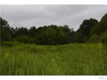 5.67 Acres of land for sale.  GREAT OPPORTUNITY!! Incredible 5.67 acres of mostly level, partially cleared land in city limits of Sanford. This tract is zoned light industrial and is in prime location with over 300' road frontage on US 421 and adjoins railroad tracks in rear.   http://www.ericandrewsrealtor.com/for-sale/TBD-Boone-Trail-Road-Sanford-NC-27330/1969433/89/