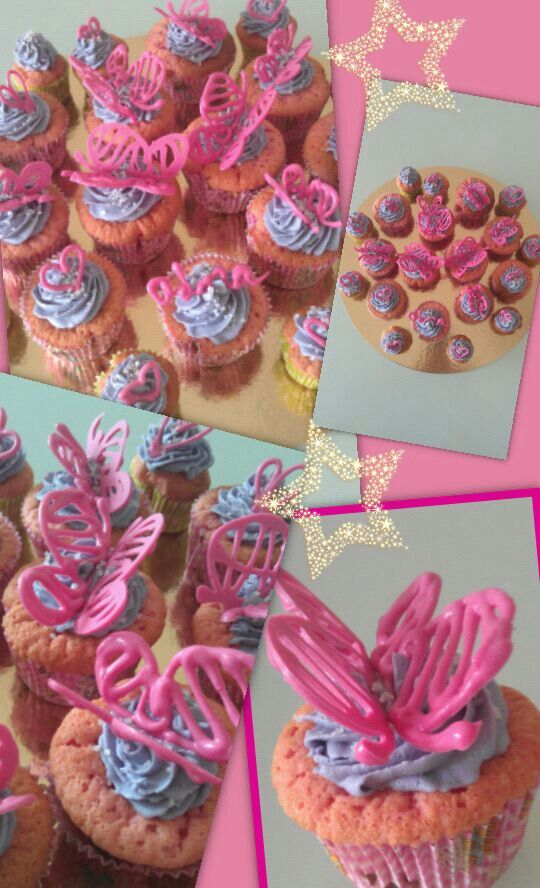 Pink cupcakes with violet buttercream and pink chocolate butterflies, something sweet to celebrate the birth of a newborn girl nextdoor...
