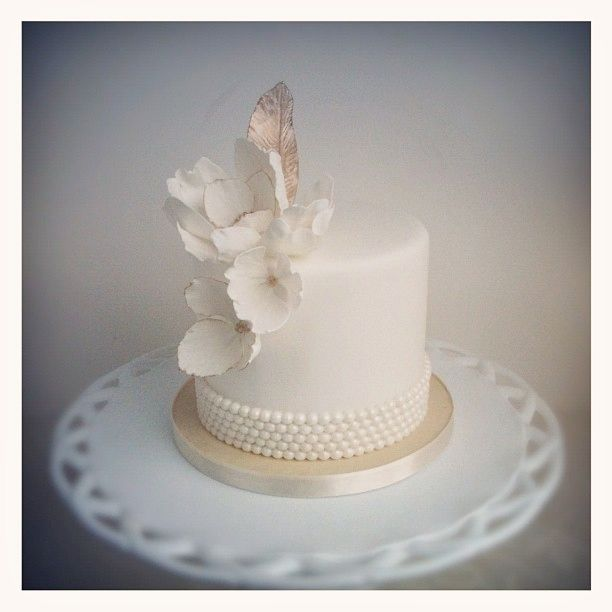 A Soft Charm: White Wedding Cake With Flowers, Feathers