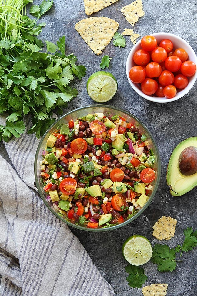 Easy Black Bean Salad with corn, avocado, tomatoes, red pepper, cilantro, and lime. The perfect sum