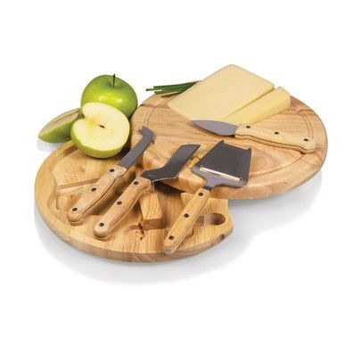 "The Circo cutting board is so compact and convenient, you'll wonder how you ever got by without it! This 10.2"" (diameter) x 1.6"" circular chopping board is made of eco-friendly rubberwood, a hardwood known for its rich grain and durability. The board swivels open to reveal four stainless steel cheese tools with rubberwood handles. The tools include: 1 cheese cleaver (for crumbly cheeses), 1 cheese plane (for semi-hard to hard cheese slices), 1 fork-tipped cheese knife, and 1 hard cheese…"