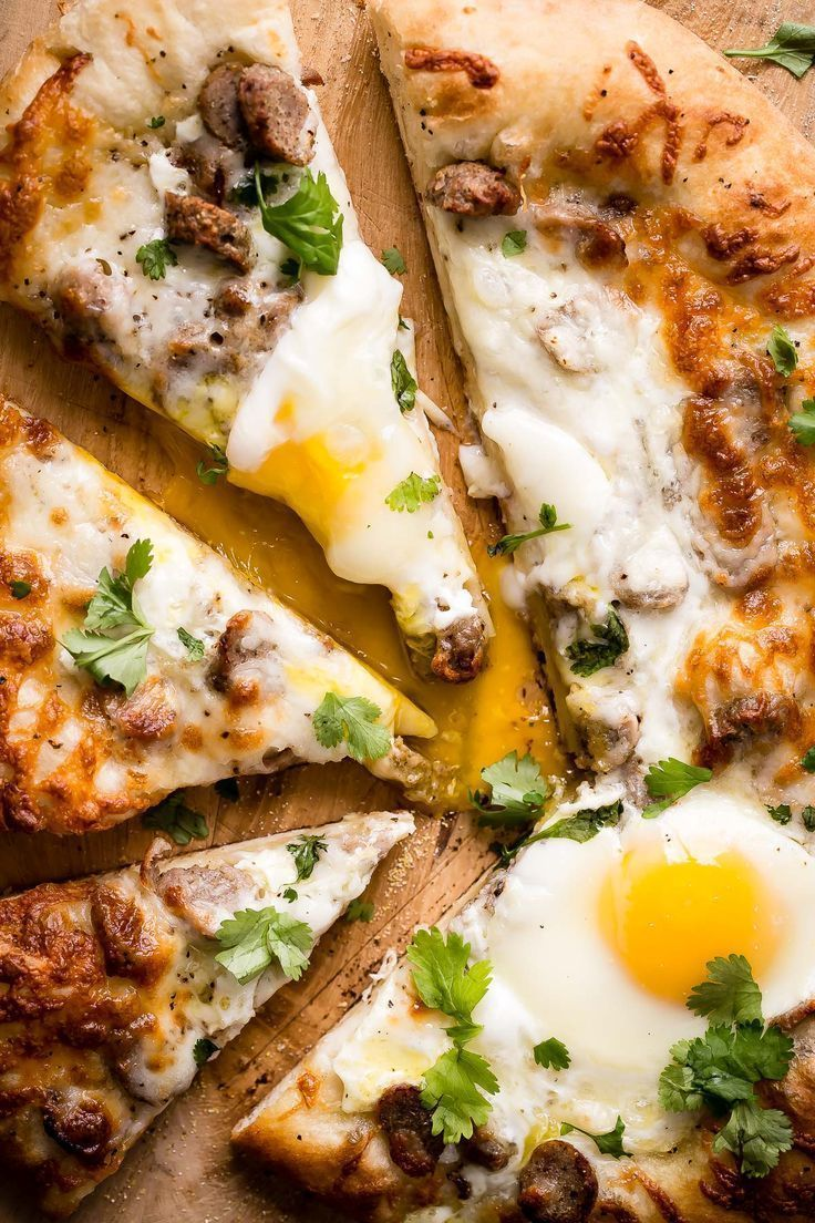 Choice Chewy pizza dough topped with sausage cheese and egg makes this a great breakfast pizza choiceChewy pizza dough topped with sausage cheese and egg makes this a gre...