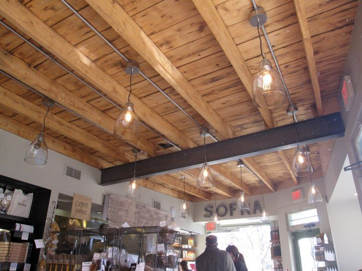 Rustic Exposed Beam Ceiling In A Shop Exposed Basement Ceiling Exposed Beams Ceiling Basement Ceiling