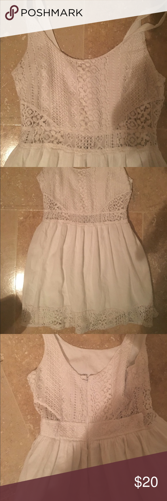 Hollister White Lace Cut Out Dress Super cute Hollister dress. It has a lace cut out at the waist, but does not show much skin at all. I have actually worn this to school with no problems. Size XS and TTS. I can model if need be but it is a bit small on me now. Perfect condition! Hollister Dresses