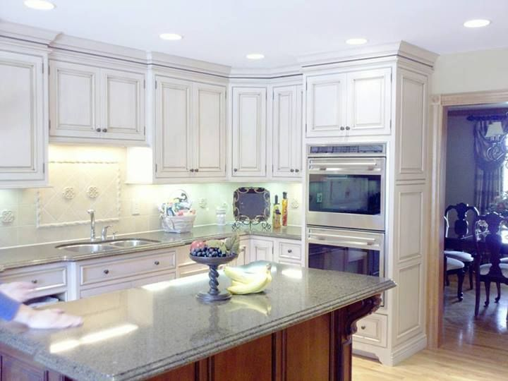 Traditional kitchen with dark island and inset cabinetry | Keidel Supply | Designer Dan Shank