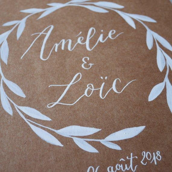 Photo of Guest Book custom calligraphy names wreath kraft sheets. Rustic and original wedding. Guest book cus