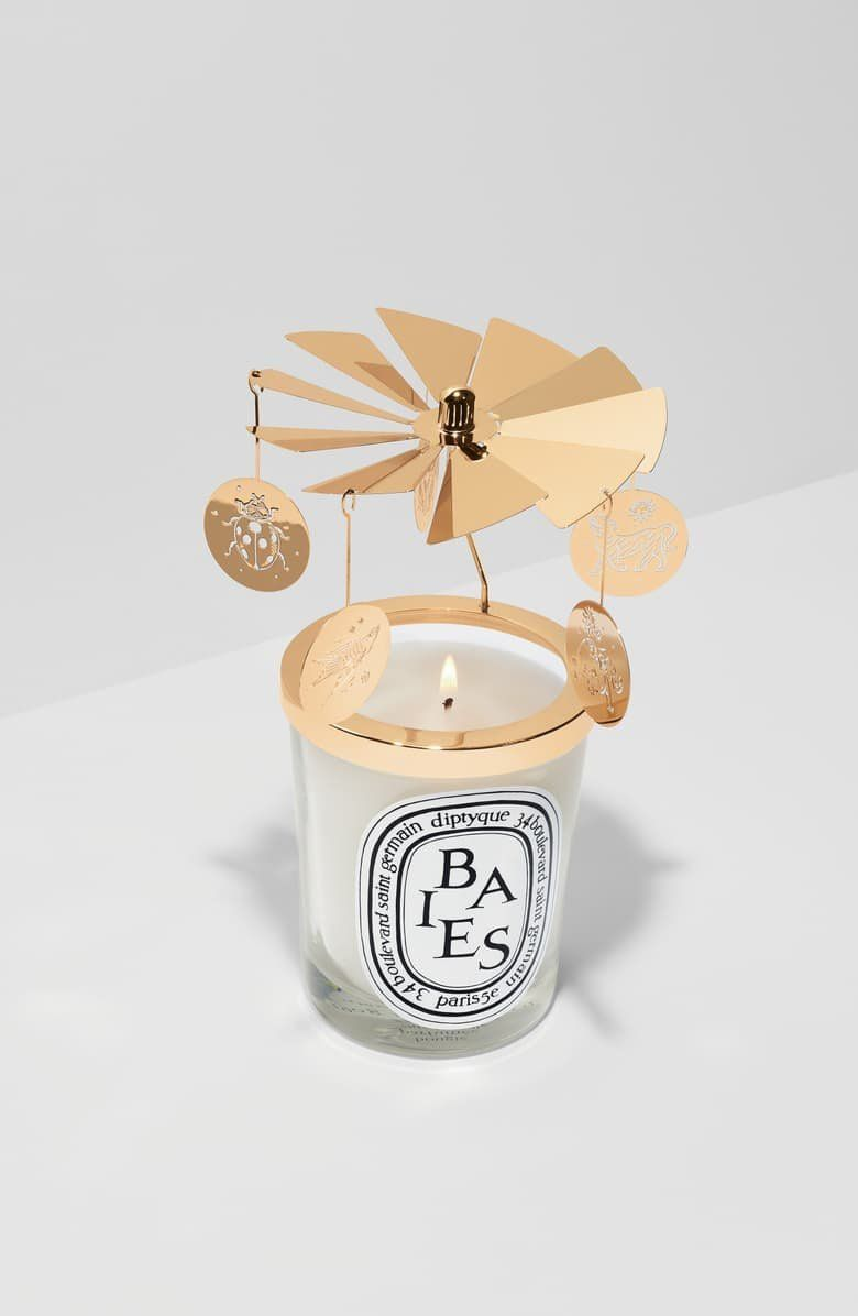 What It Is A Limited Edition Carousel Adorned With Five Lucky Tassels That Glow In The Light Of Your Chosen Diptyque Can Candle Charms Candles Selling Candles