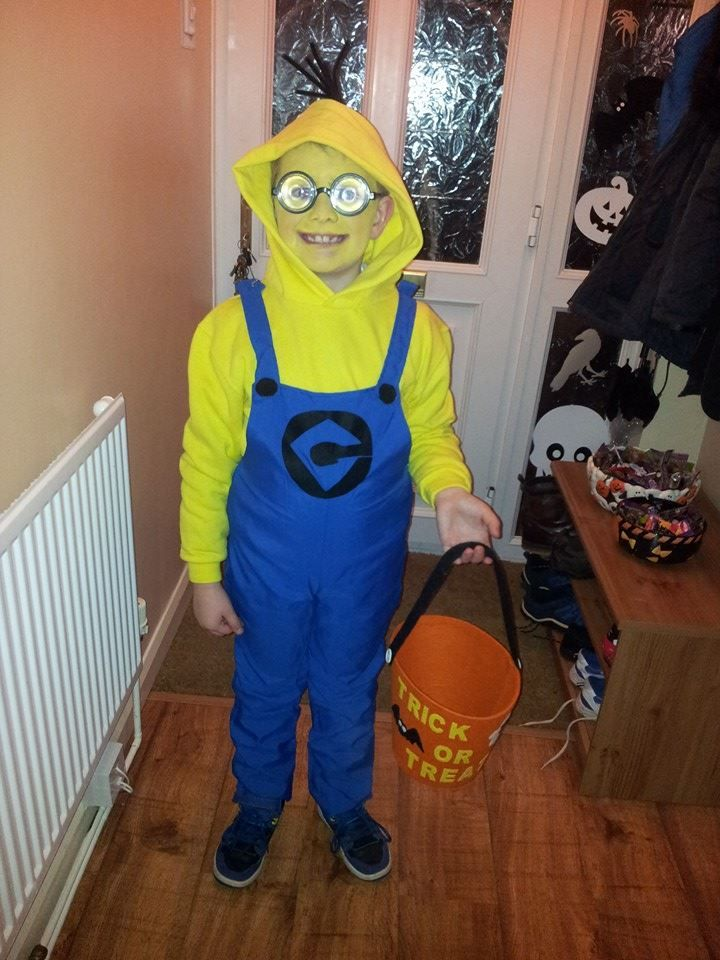 Home made minion costume. Yellow hoody, dungarees from a Super Mario costume, adhesive felt, plastic googles and yellow face paint