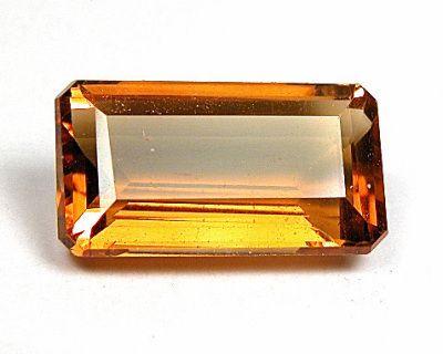 Gemstone: Citrine Weight:  35,98ct Size:  31.5 x 13 x 10.5mm Color: Honey Golden Yellow Shape: Emerald Cut Cut:  Sri Lanka Clarity:  IF  Flawless Origin: Nigeria