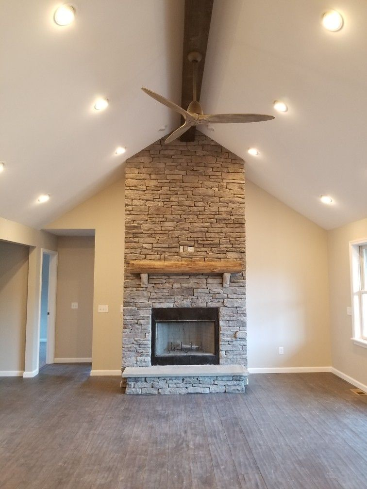 Stone Fireplace Vaulted Ceiling And Wood Beam Beams Living Room Lighting