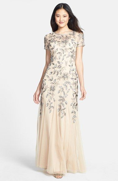 Adrianna Papell Floral Beaded Trumpet Gown, Delicate, beaded blooms decorate a light, ethereal gown tailored with a sheer yoke and sleeves. The classic silhouette stays fitted through the body before gently flaring into a soft, godet-inset trumpet hem.