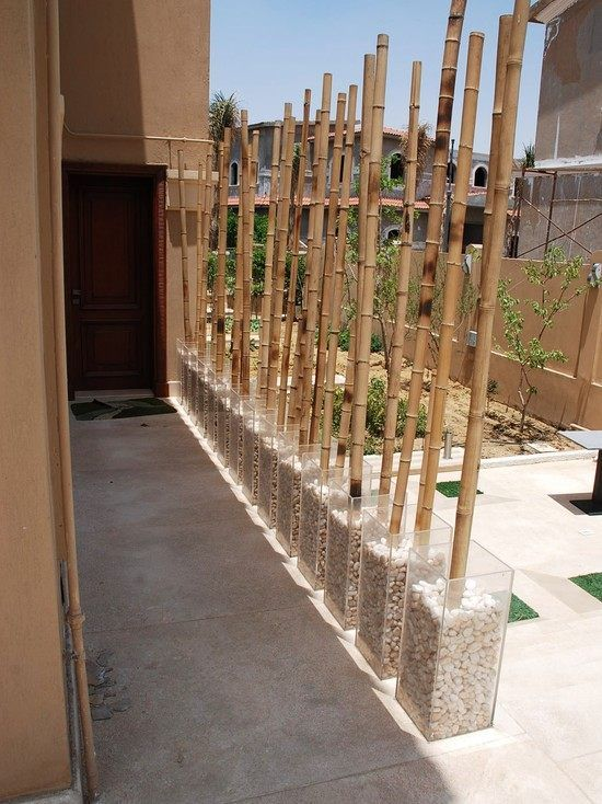 patio decoration transparent pots pebbles and bamboo tubes