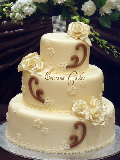 Brown and Ivory Wedding Cake - make it square, add some horseshoes ...