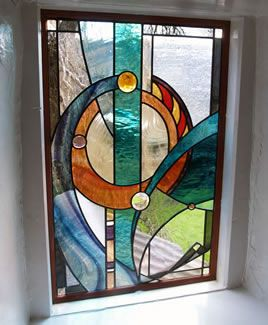 Contemporary abstract panel for stairwell, 2005. Made with English Antique streaky, Spectrum waterglass, Kokomo cathedral, pencil bevels and glass nuggets.