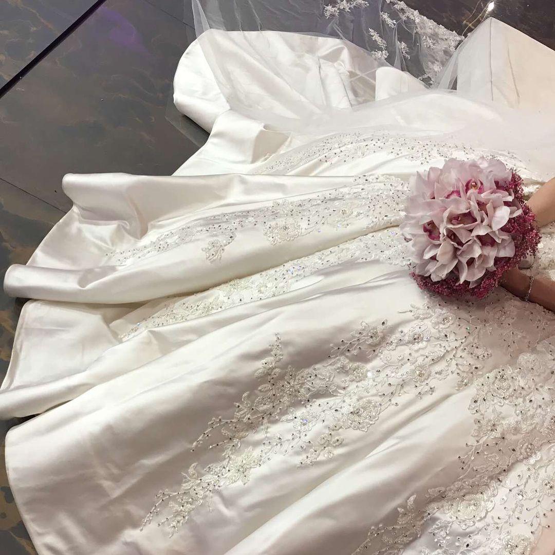 صور متعددة لتفاصيل فستان عروستنا ماشاء الله ليله جميلة و مميزة الله يوفق العرسان و يهنيهم يارب Wedding Wedding Dresses Lace Wedding Dresses