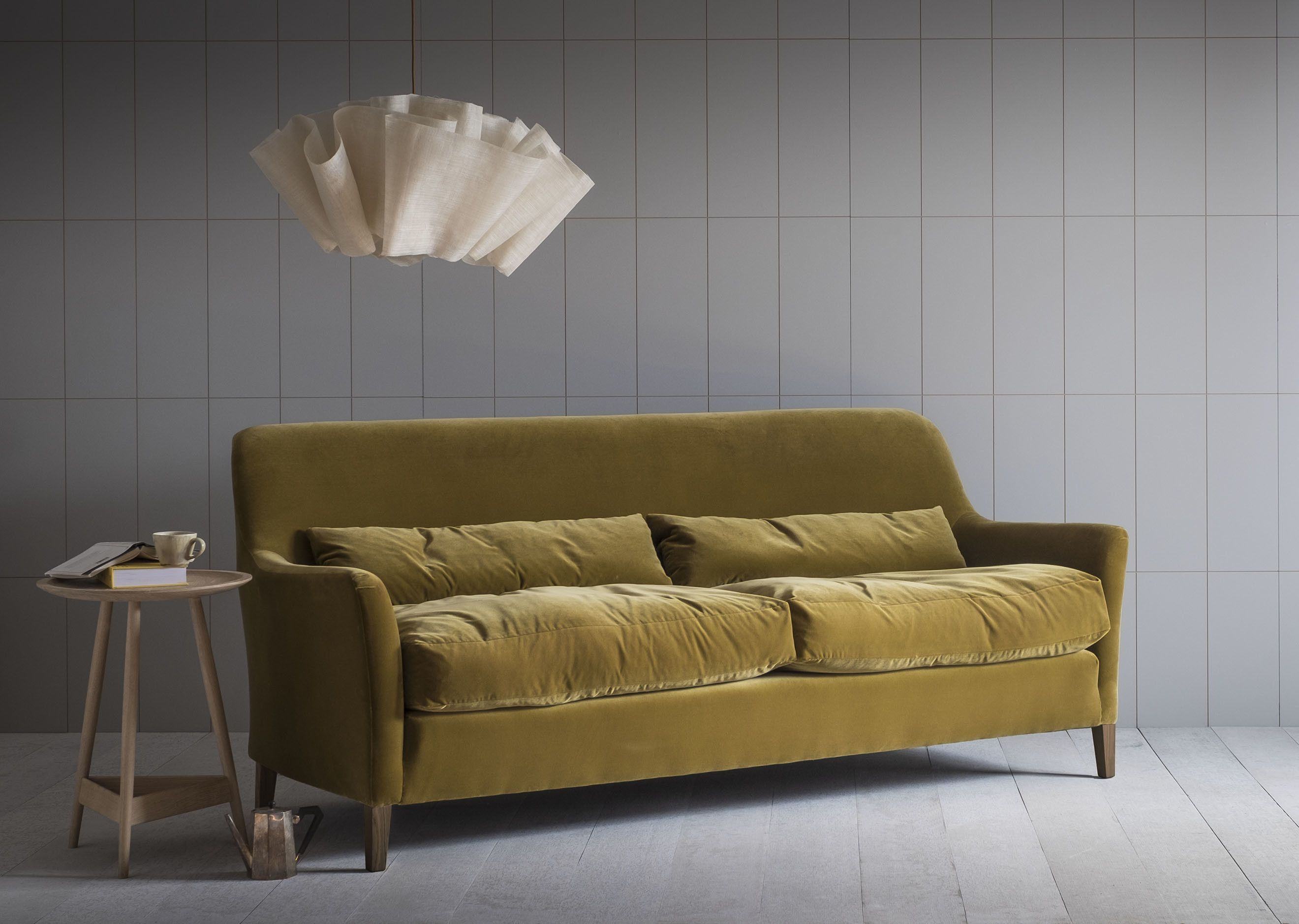 A Generous Cushioned Sofa With High Back Available In Two Lengths