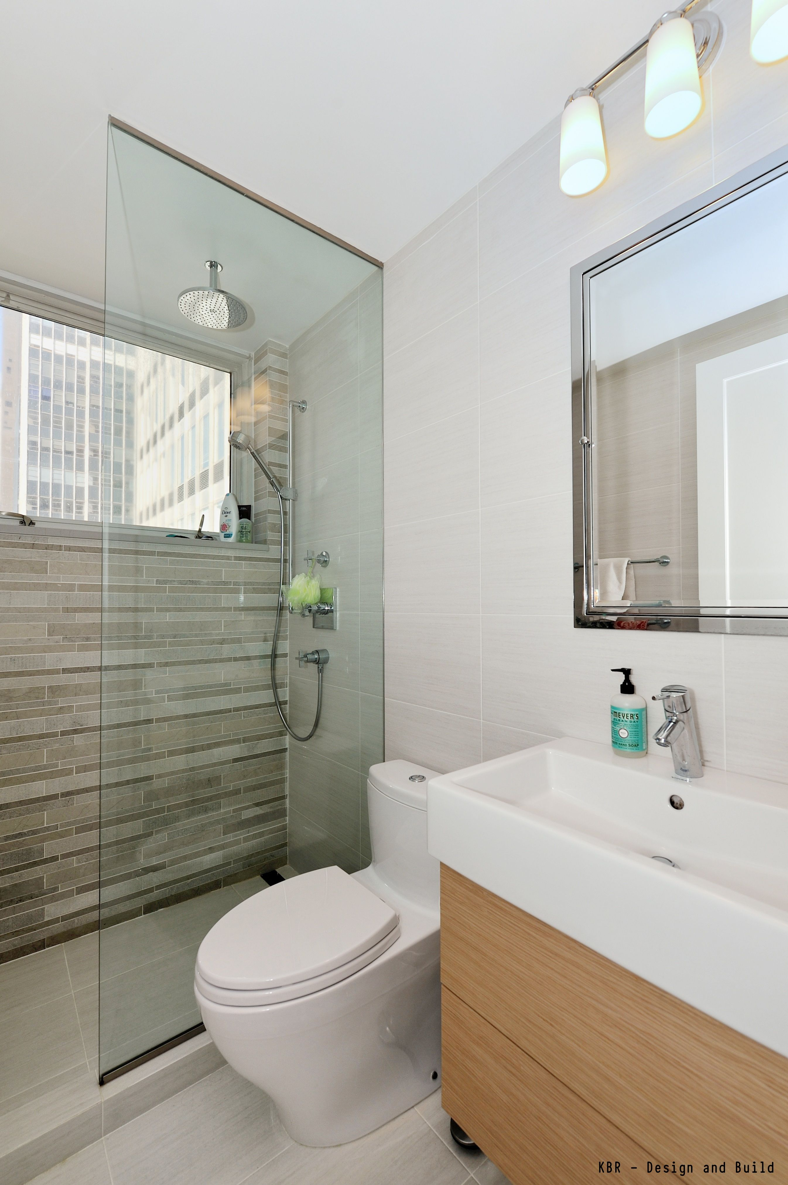 A Decent Size Shower With A Window, Accent Wall And