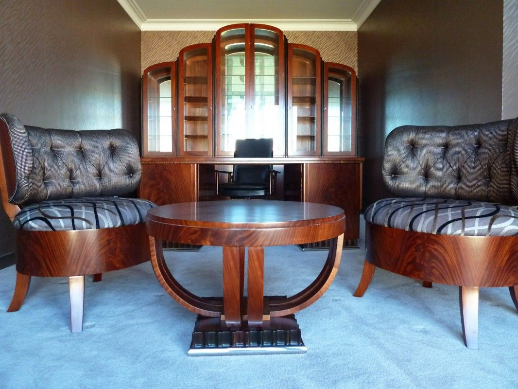 Art deco office featuring chairs and bookcase custom