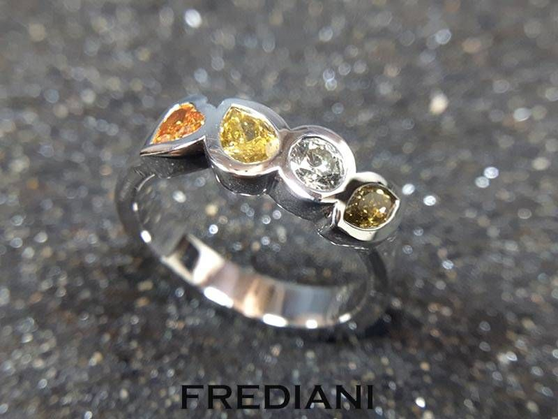White gold and colored diamonds ring