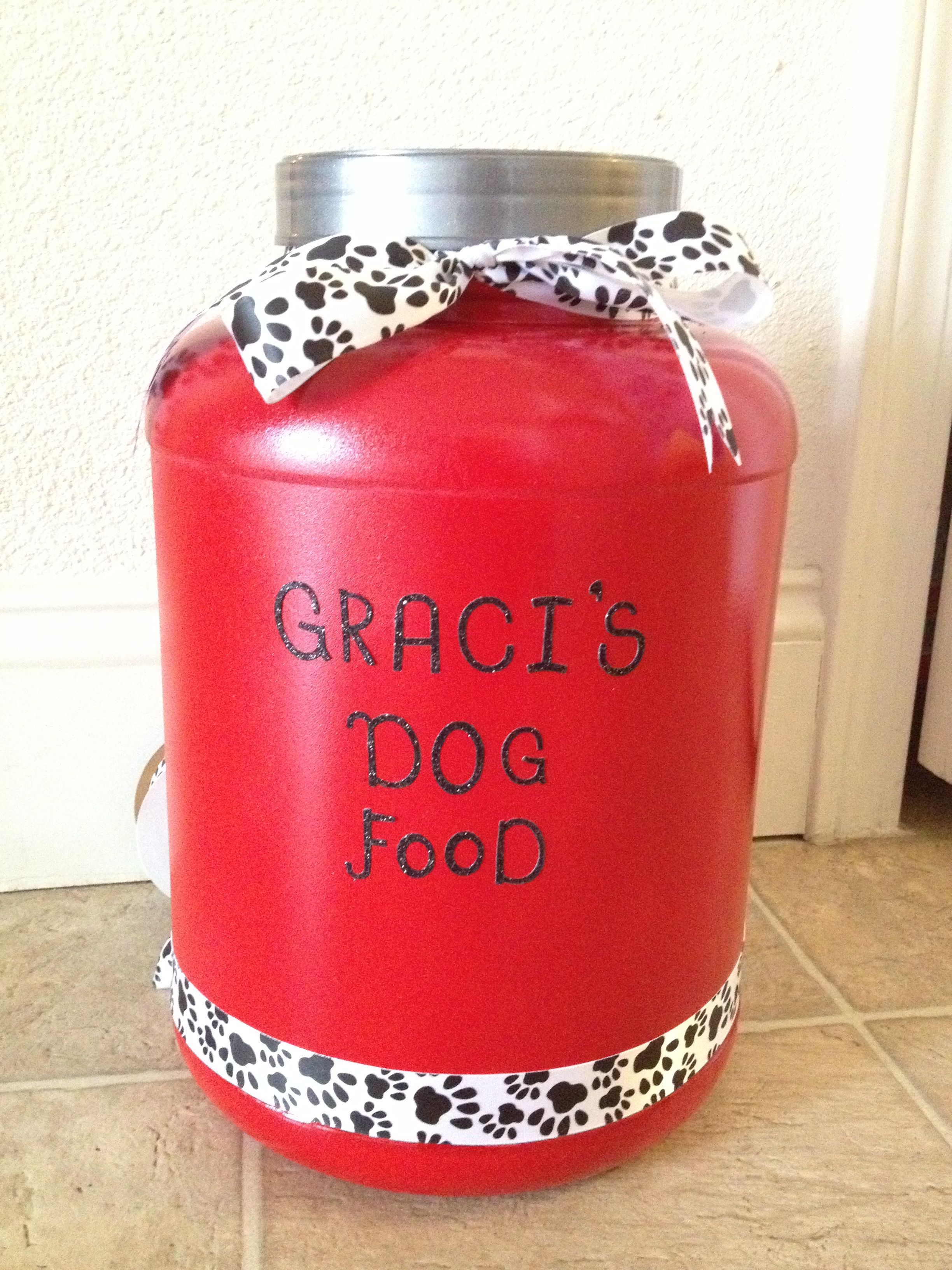 Dyi Dog Food Container I Took My Husbands Whey Protein Container And Spray Painted It And Bam Created For Anothe Dog Food Container Diy Dog Food Diy Dog Stuff