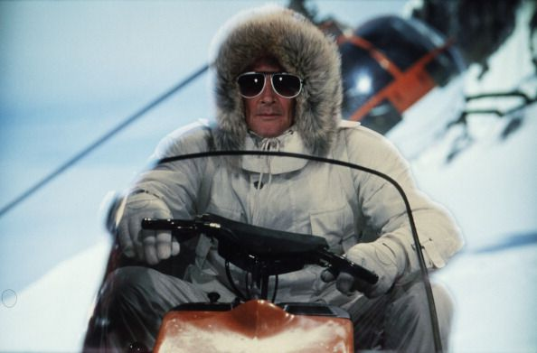 A Matte Shot Of English Actor Roger Moore As 007 Driving A