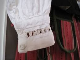 The beautiful whitework on the shirt of Hartola costume - buttons are sewn