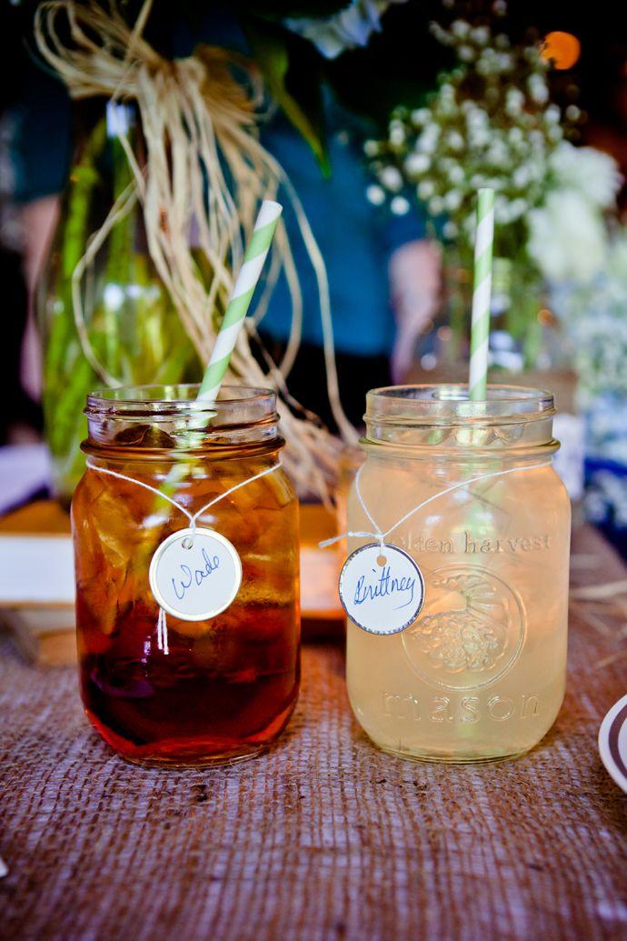 mason jar glasses. Could be fancier with a tiffany blue Ribbon and straw