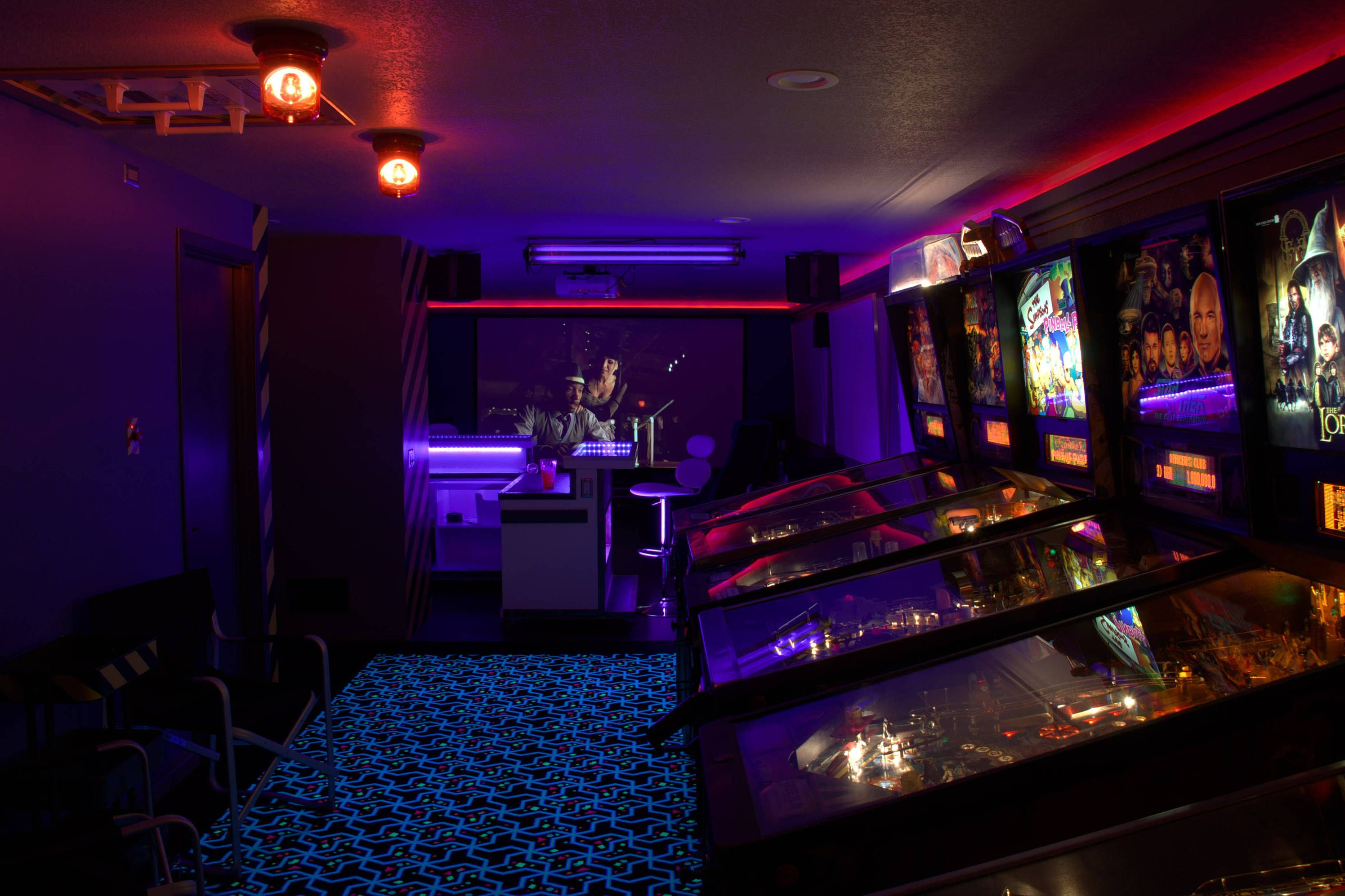 Sci fi themed arcade game room bar and theater by Reddit user