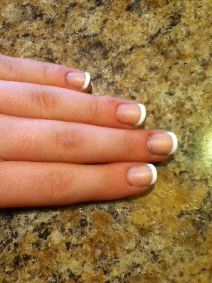To make fake nails look more natural, apply a matte top coat over ...