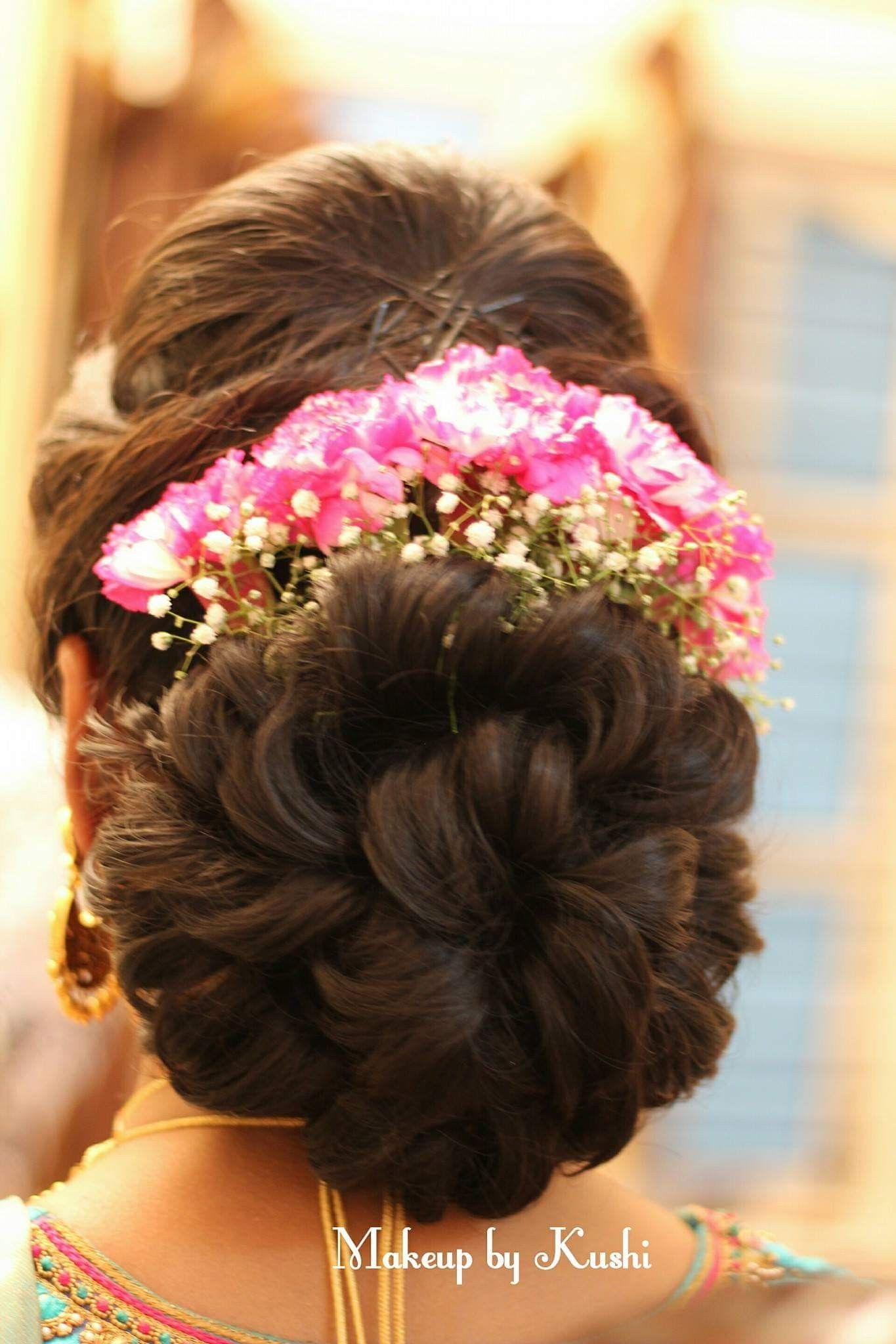 What A Beautiful Large Low Bun With Real Flower Gajra Care However Should Be Taken Before Adopting Such H Bridal Hair Buns Hair Styles Bridal Hair Decorations