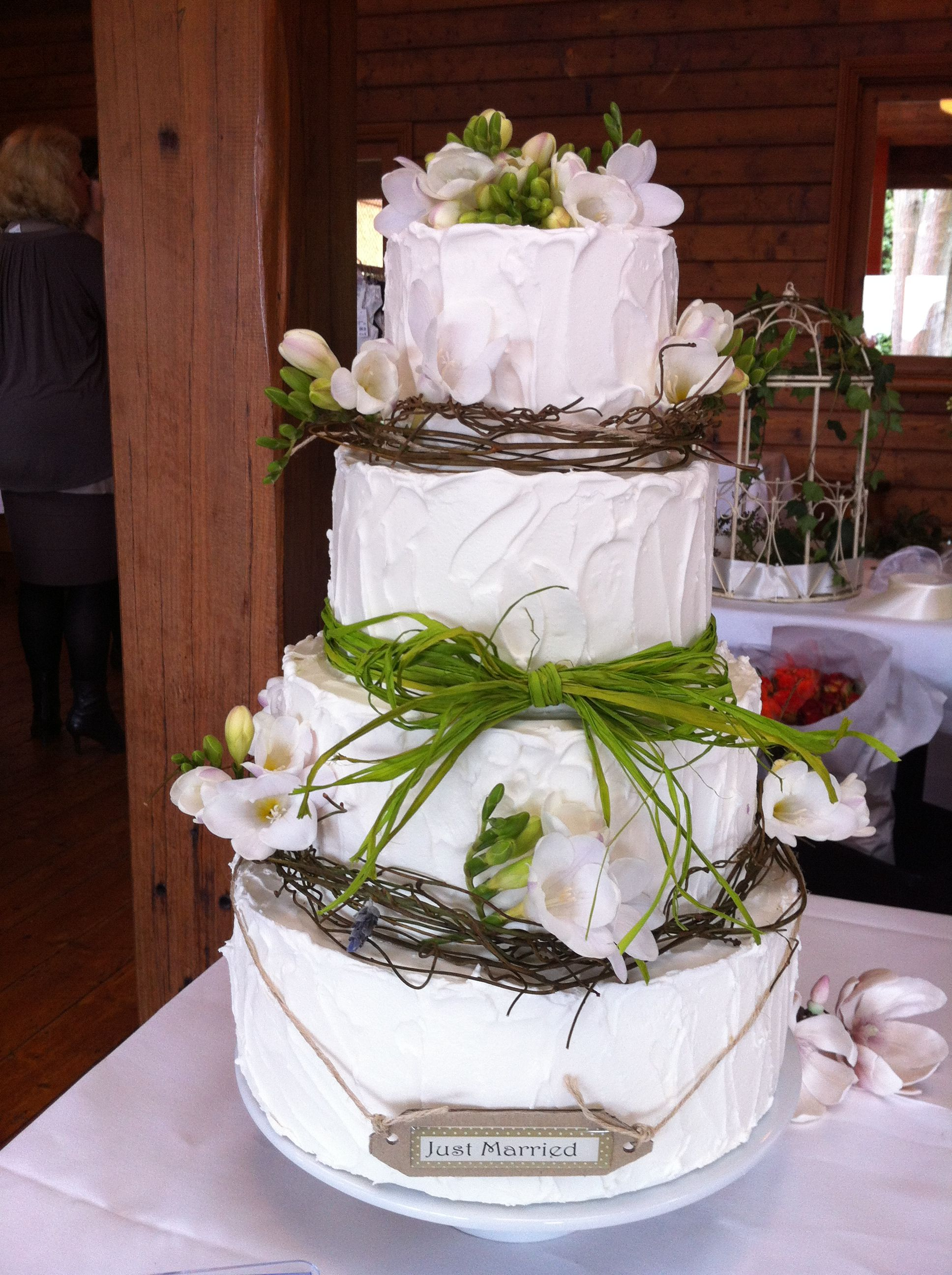 Rustic Wedding Cake Covered In Rough Royal Icing And Decorated With Dodda Vine Raffia