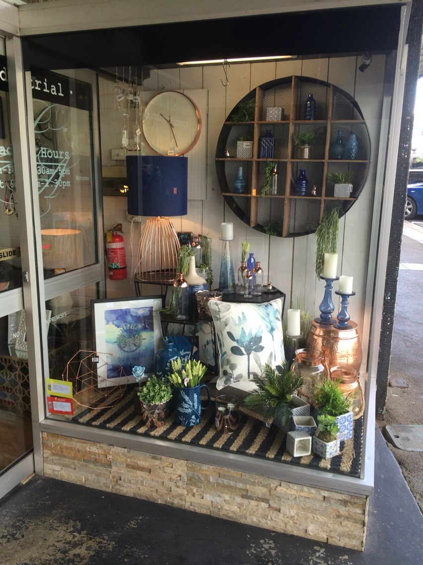 Love this navy and copper window display from a few months for Boutique window display ideas