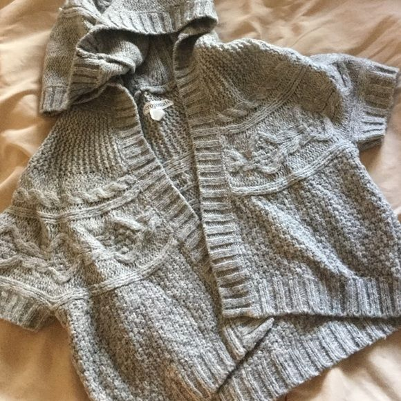 """Cute Gray Cable Knit Shrug w/ Hood Simple shrug with a hood. Open front, No buttons or zippers. Not really heavy and is cropped to just below bust line. About 16"""" from top of shoulder to bottom hem. Only worn a few times. 77% Acrylic, 21%Cotton, 7% Wool. Aeropostale Sweaters Shrugs & Ponchos"""