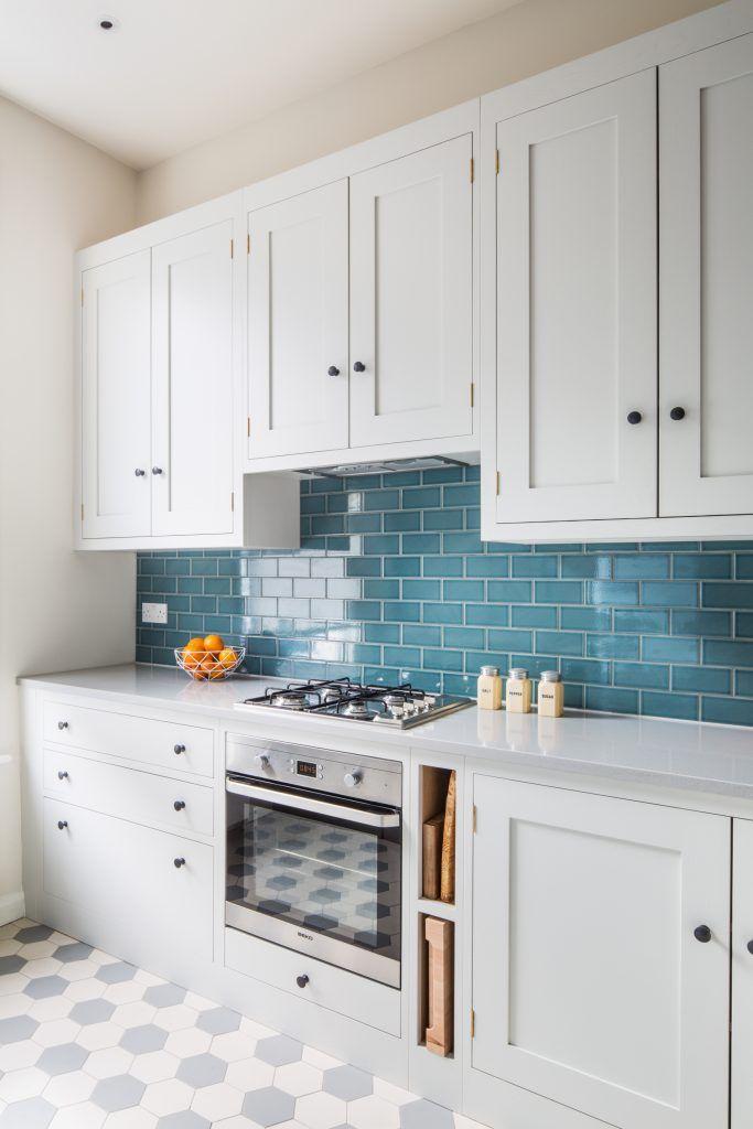 oak shaker kitchen with blue green tile splashbacks the