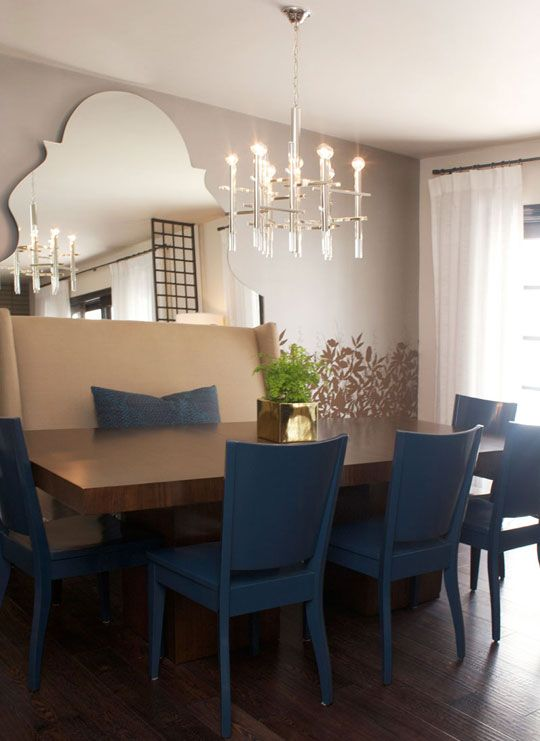 yes, yes, yes! this is an awesome way to integrate a mis-matched set of chairs of course, but the white banquette with the blue pillow tie-in is just awesome! Love it!