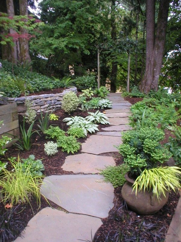Flagstones Stepping Stones With Images Sloped Garden Wooden Garden Planters Landscaping Supplies