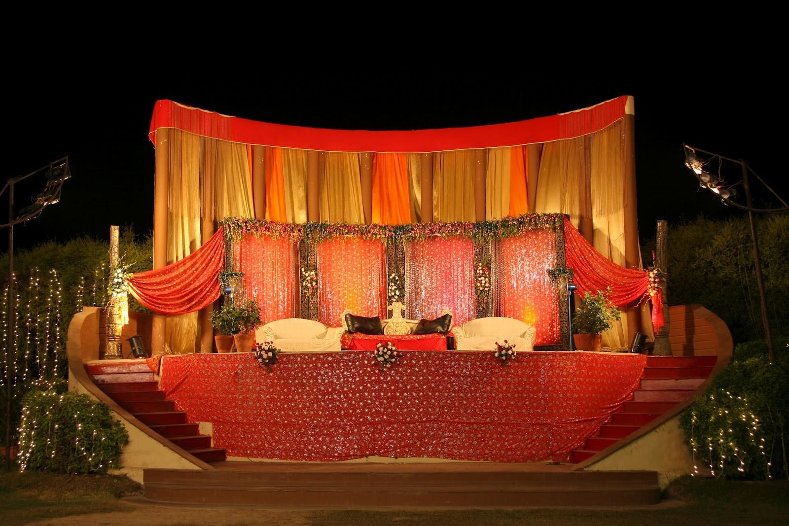 Outdoor indian wedding stage decorations wedding stage for Background stage decoration