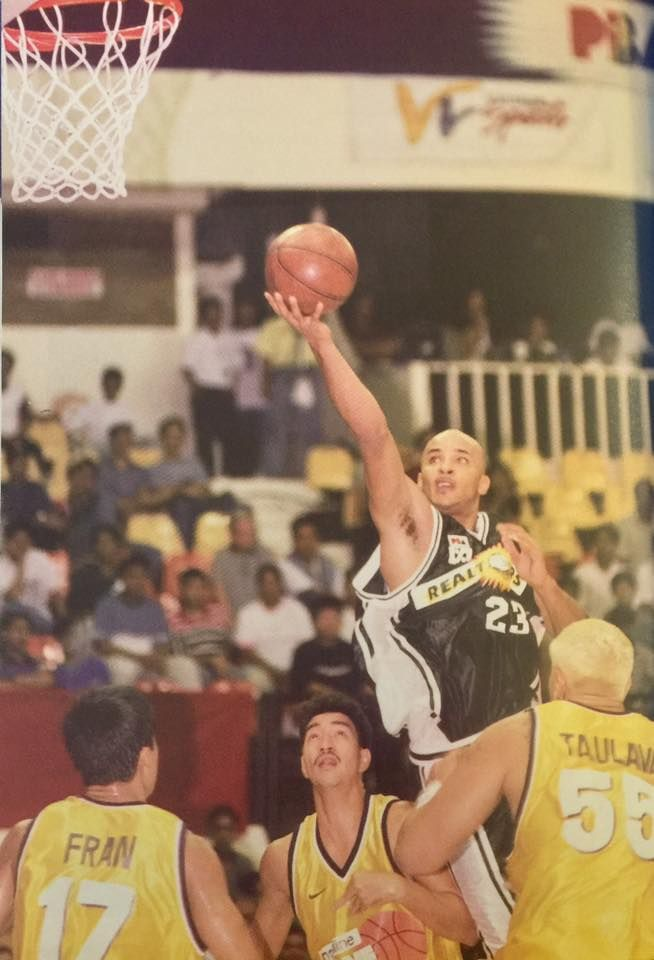 Rob Parker of the Sta. Lucia Realtors takes a layup against Mobiline Phone  Pals during the action of the 1999 PBA Commissioner s Cup. cd6dfdf09