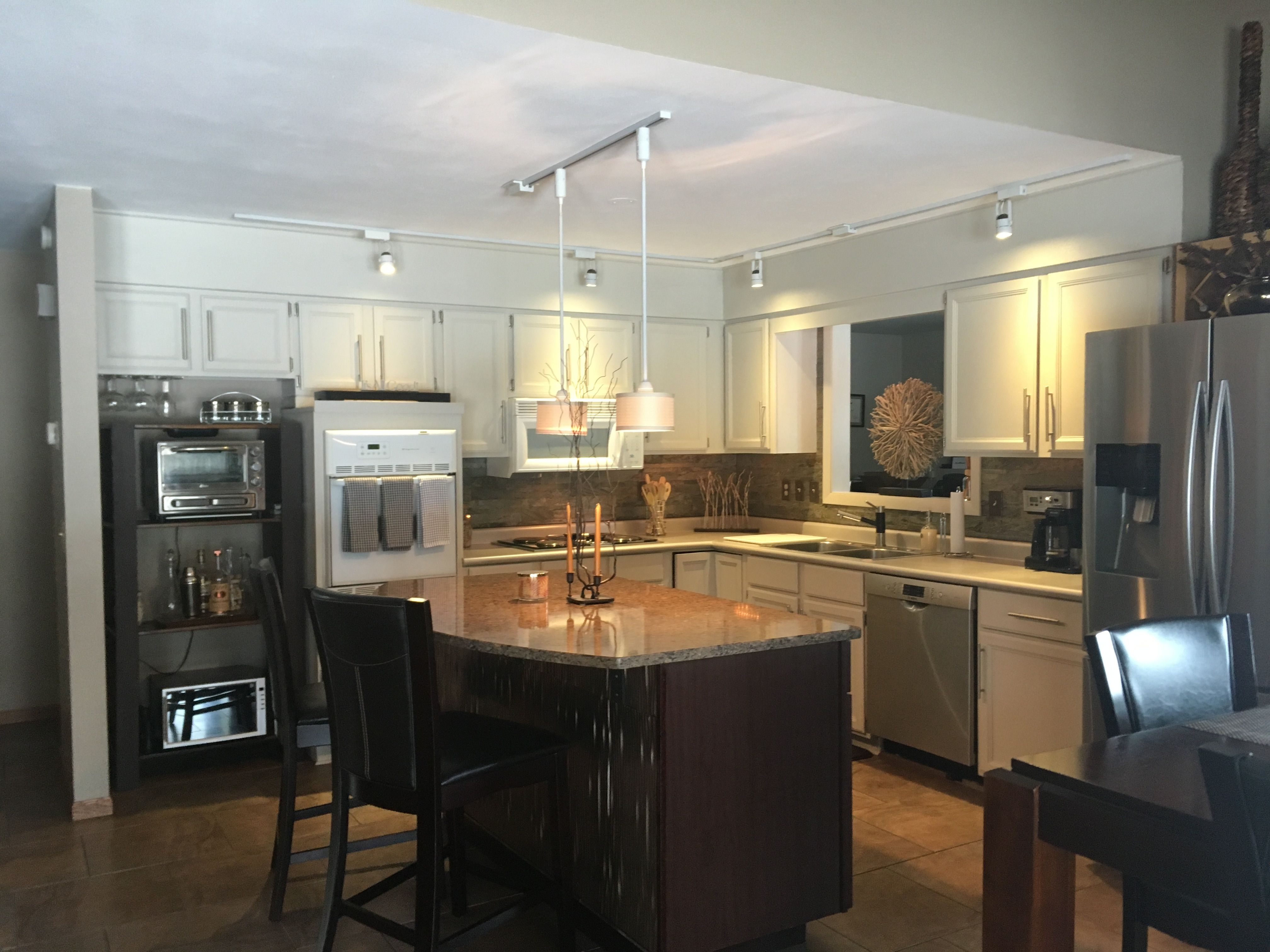 This new island i had cherry cabinets installed and a silestone