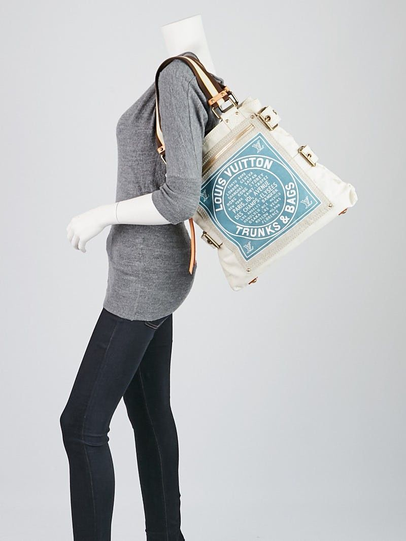 1ff636dedb07 The Louis Vuitton Limited Edition Blue Toile Globe Shoppers Cabas MM Tote  Bag is a playful yet elegant tote that pays tribute to Louis Vuitton s rich  ...