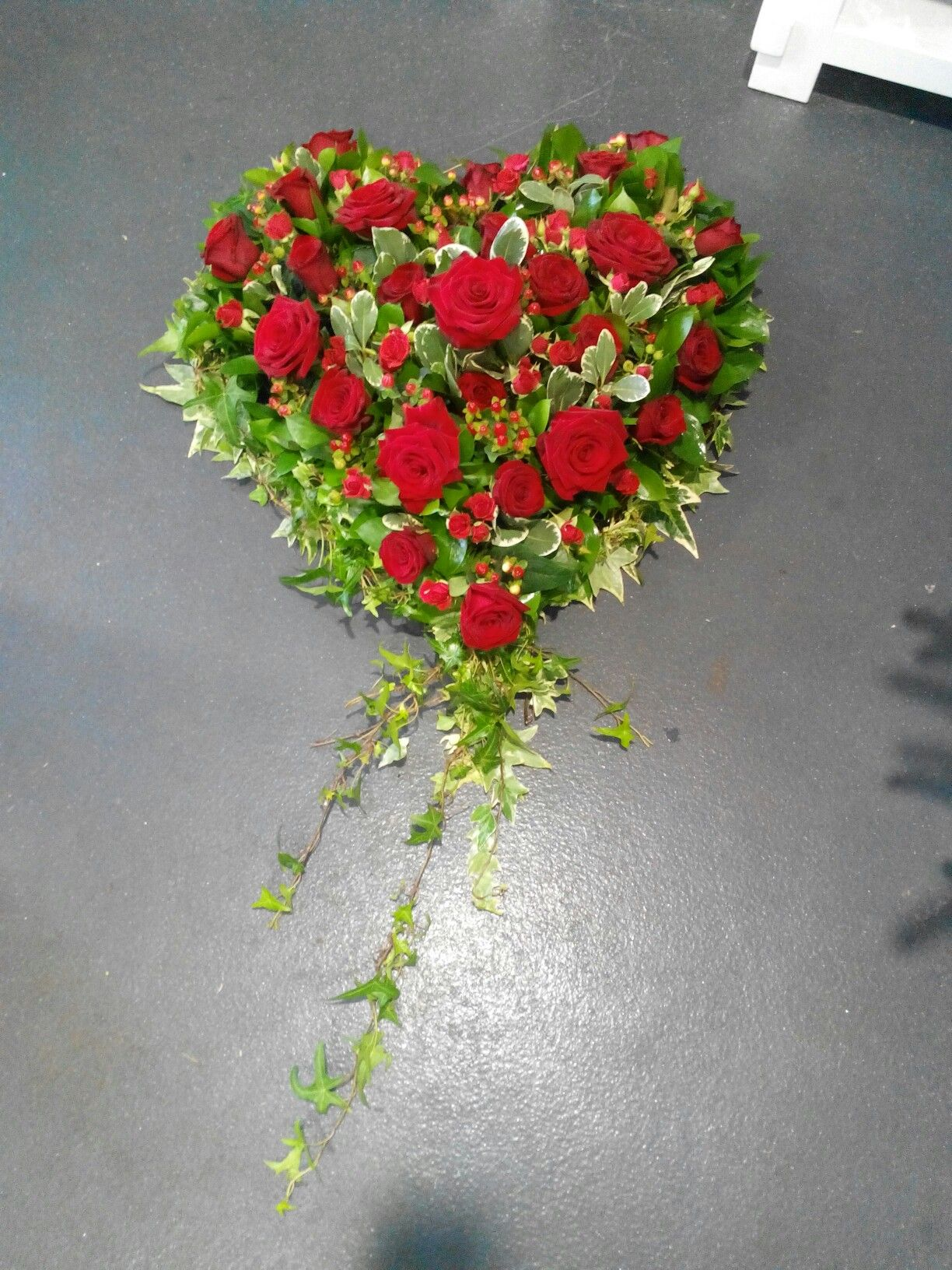 A stunning heart of red roses a beautiful funeral tribute