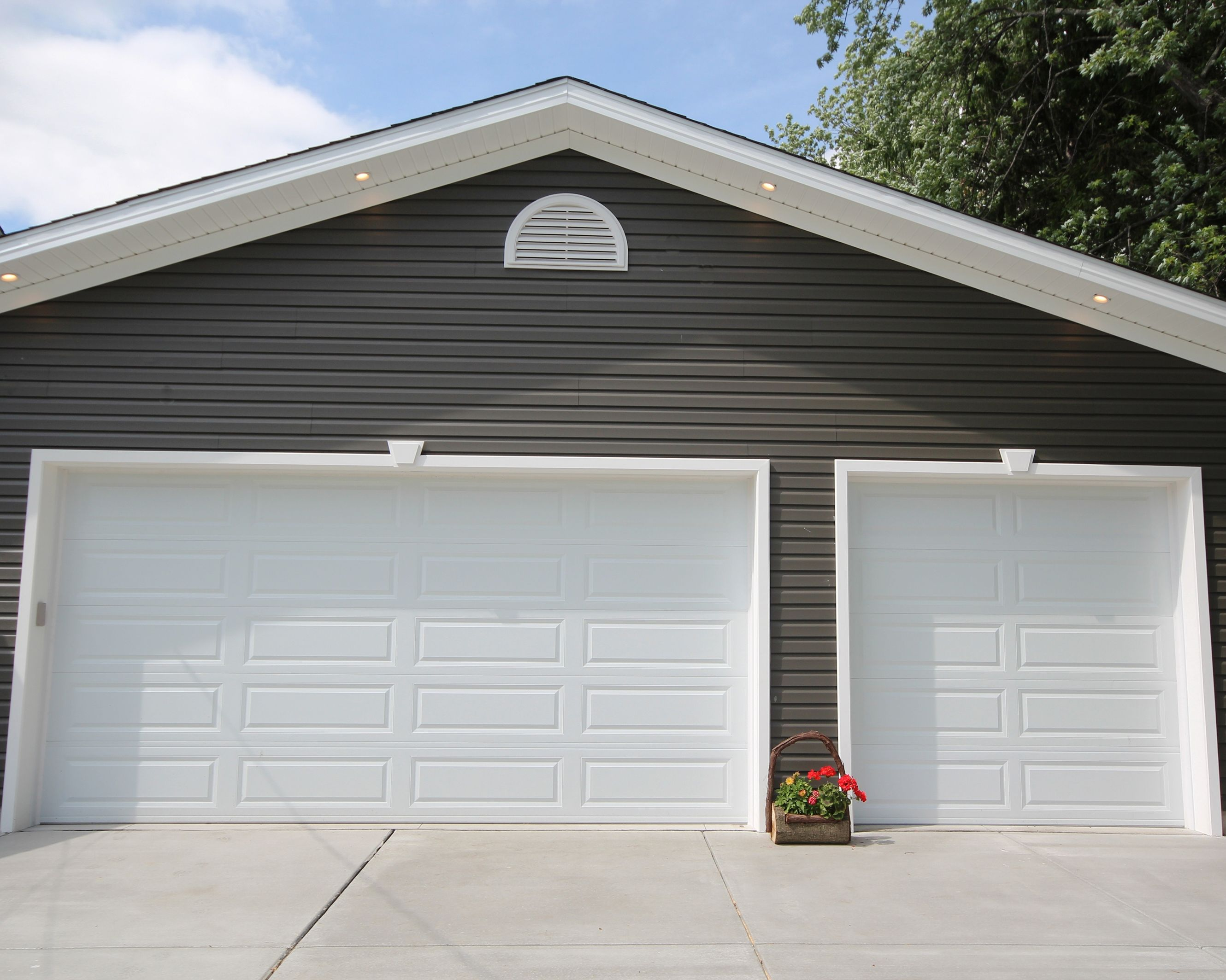 entry wilde completes garage atlas pdf january door new joe controller access remote rolling expansion genie launches