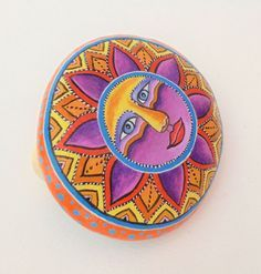 Colorful Sun Hand painted On A Round Sea Stone by RockArtAttack