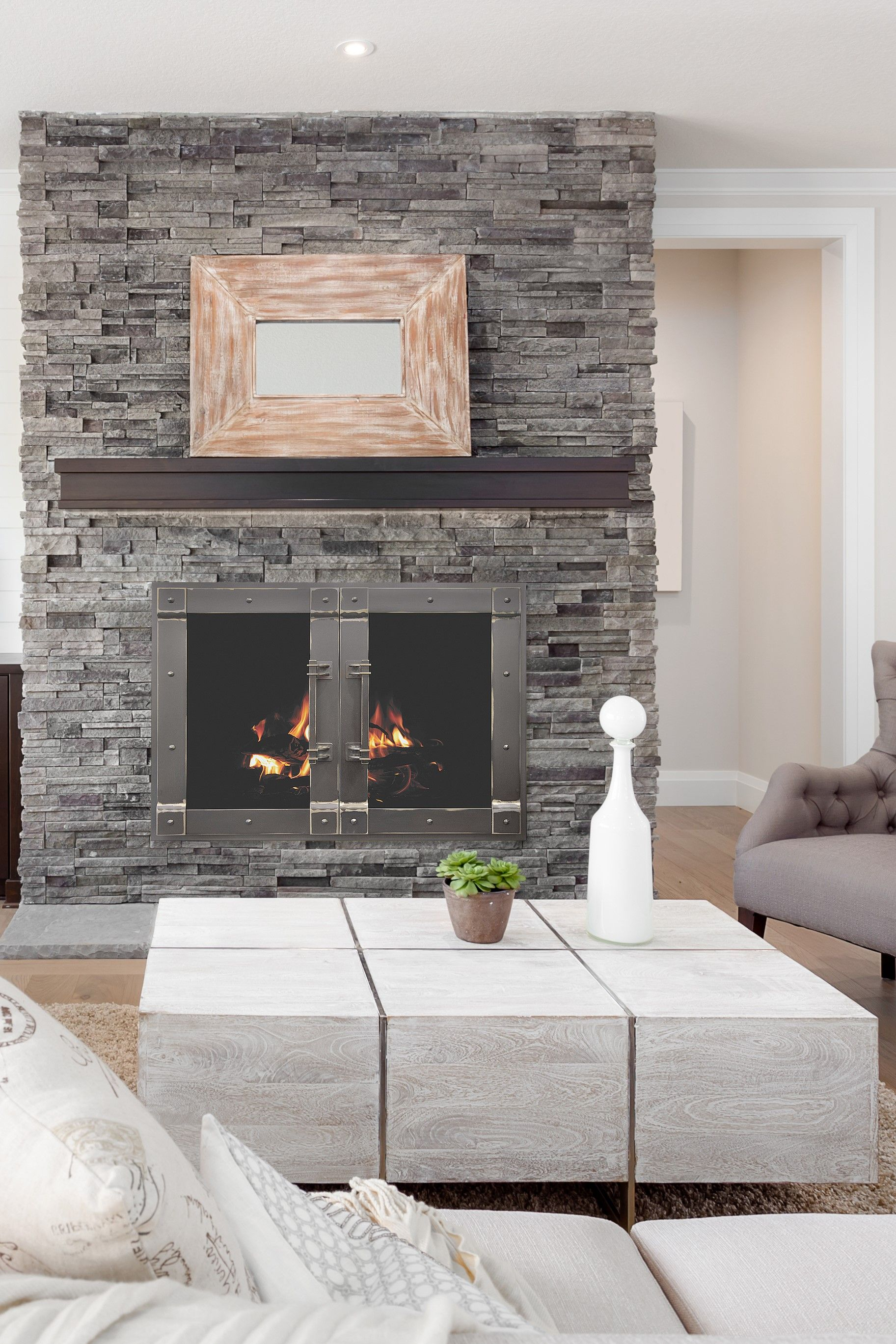 Adding Fireplace Doors Is A Large Part Of Transforming Your Fireplace Setting Our Hand Crafted Fire Modern Fireplace Cast Stone Fireplace Stone Fireplace Wall