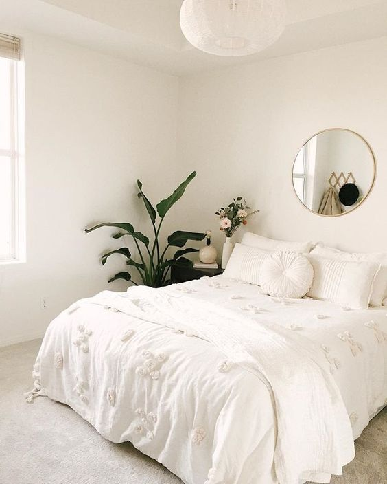 minimalist bedroom; all white with plants and gold accents ...
