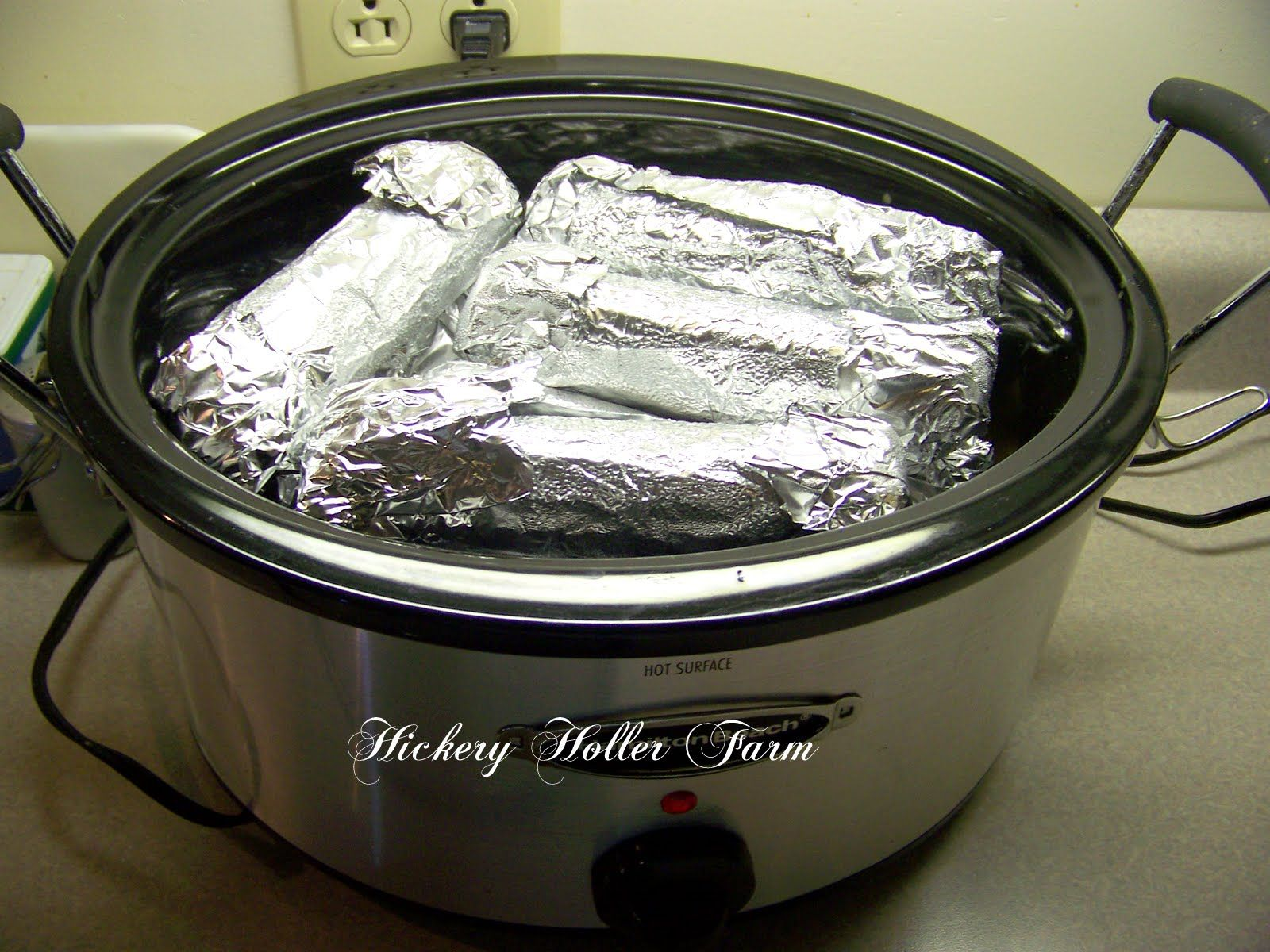 pork chops on the bottom, baked potatoes in the middle, corn on the cob on top....a complete meal in one crockpot!
