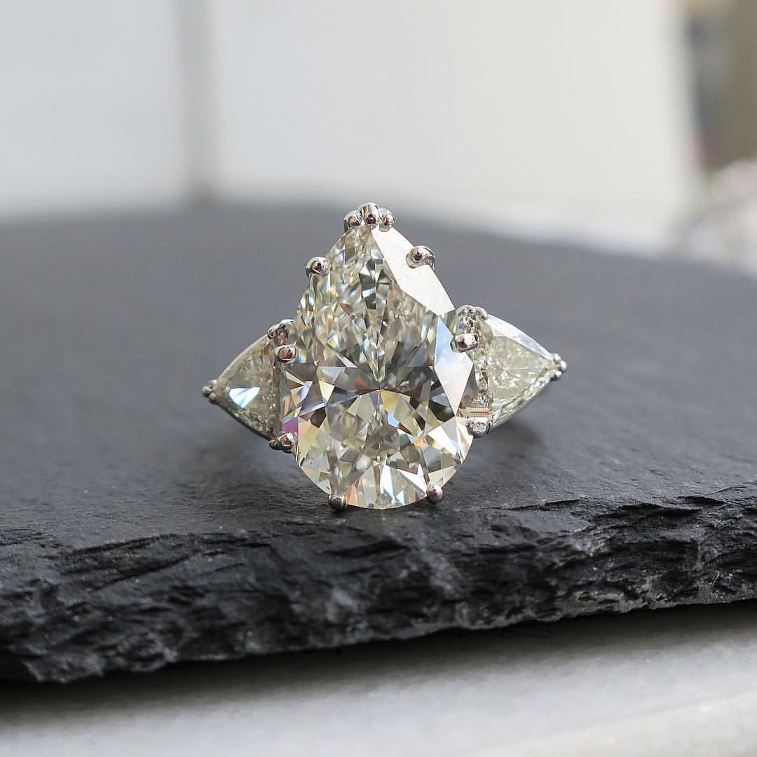 A Very Juicy 6 58 Ct Pear Shaped Diamond Ring With Trillion Side St Pear Shaped Diamond Ring Pear Shaped Diamond Engagement Rings Pear Shaped Engagement Rings