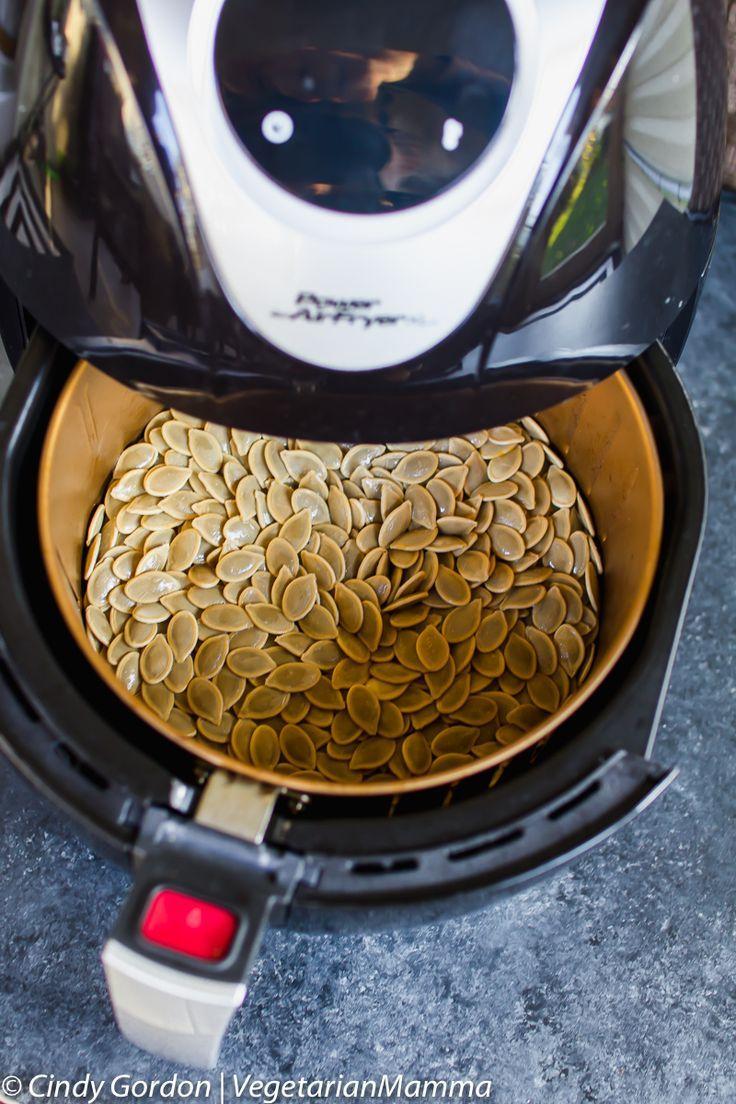 Air Fryer Pumpkin Seeds in the air fryer with basket open