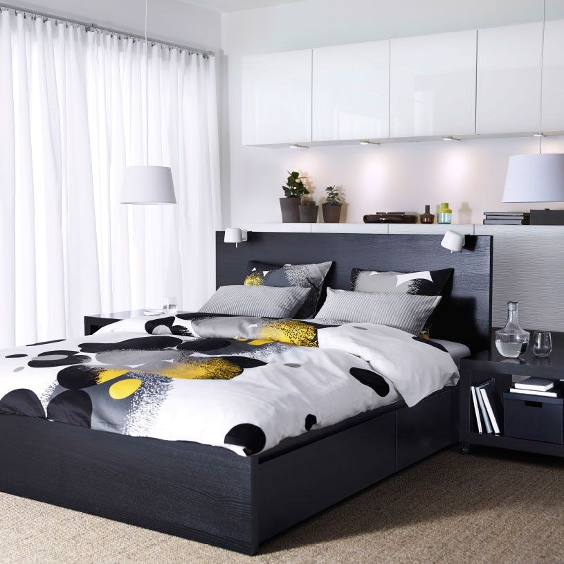 A Bedroom With A Black Brown MALM Bed, BESTÅ Storage With White Doors And  BOLLTISTEL Comforter