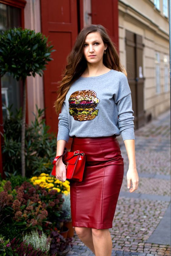 Woman wears elegant red knee-length faux leather pencil skirt with gray sweater with glittery burger design.. DIY the look yourself: http://mjtrends.com/pins.php?name=red-faux-leather-for-skirt_1
